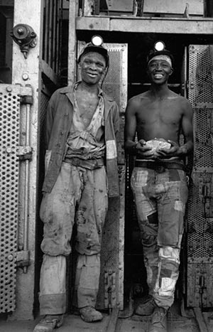 Two miners at the end of their shift, Kimberley, 1947-48.