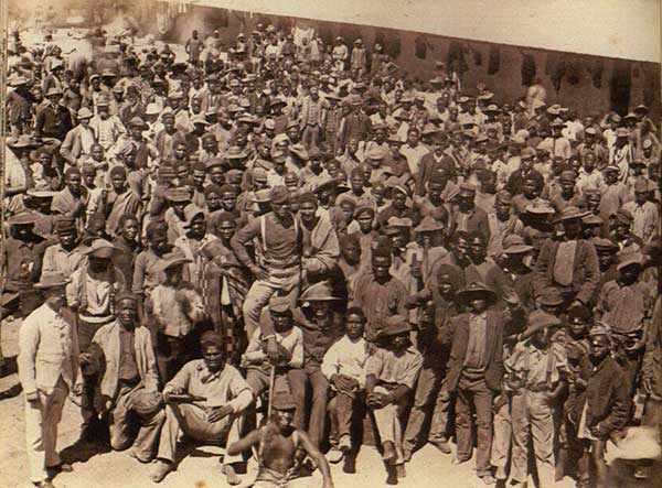 Group of workers in compound, Kimberley diamond mines.